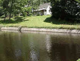 Lollipop Pond and rear of Worker's Exhibit House on Charles St., White Mills