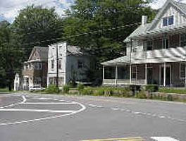 Early structures along Route 6, White Mills (former White Mills Hotel on right).